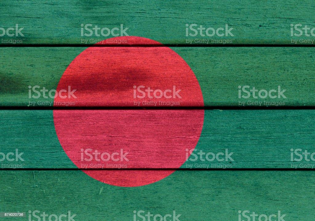 Republic of Bangladesh flag on wooden surface stock photo