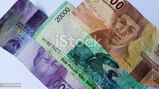 istock Republic of Indonesia banknotes on a white background 1347813188