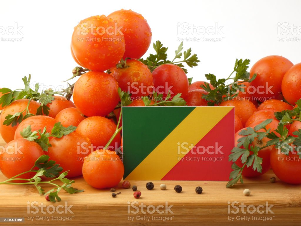 Republic of the Congo flag on a wooden panel with tomatoes isolated on a white background stock photo