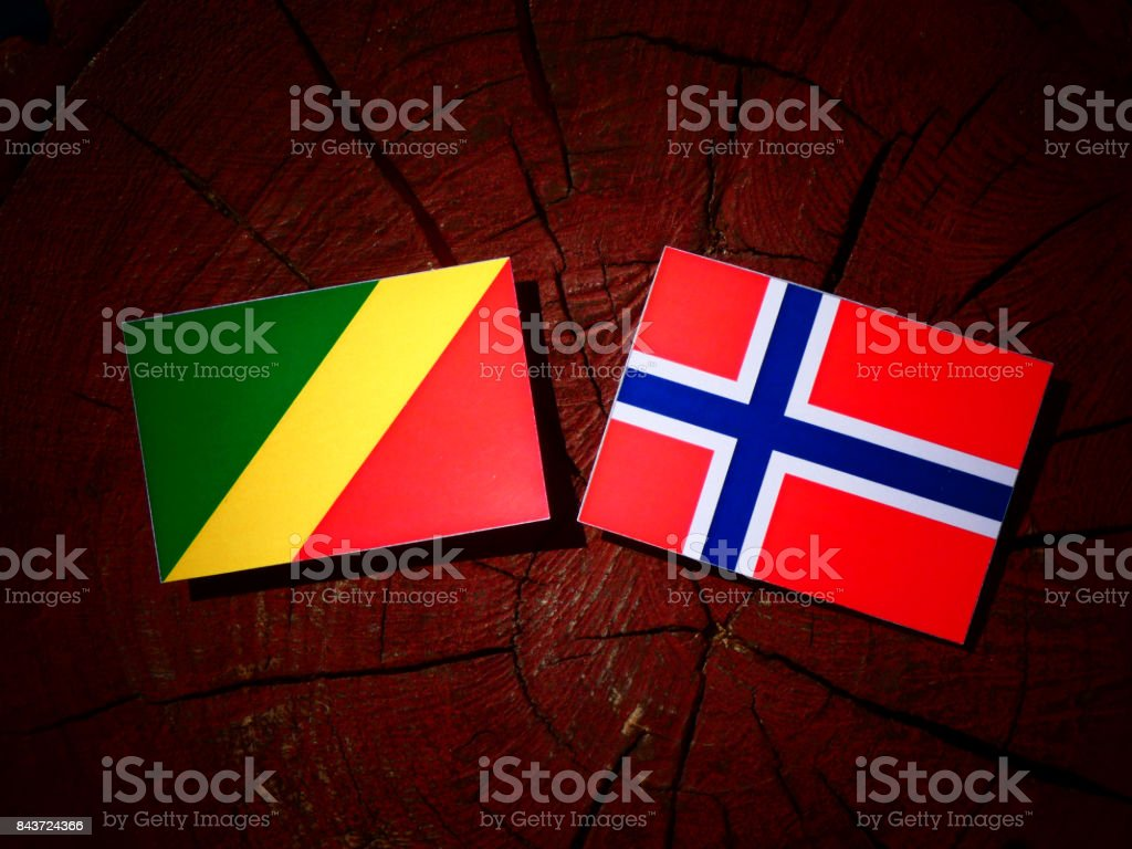 Republic of the Congo flag with Norwegian flag on a tree stump isolated stock photo