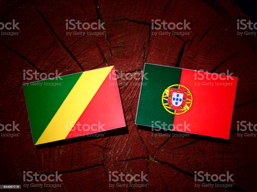 Republic of the Congo flag with Portuguese flag on a tree stump isolated stock photo
