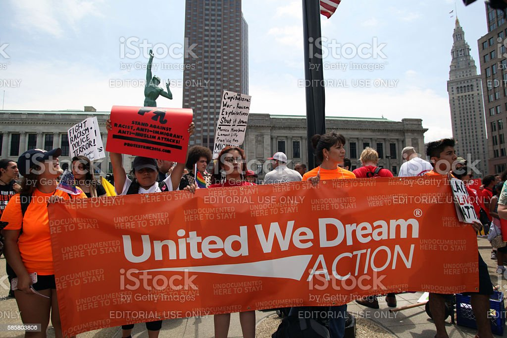 """Republican National Convention, July 18, 2016 Cleveland, Ohio, USA - July 18, 2016:  Young Hispanics support the Dream Act at the """"Stop Trump"""" march on the first day of the Republican National Convention.  DACA (the Deferred Action for Childhood Arrivals) program defers immigration enforcement action against young people brought to the U.S. illegally as children. Cleveland - Ohio Stock Photo"""