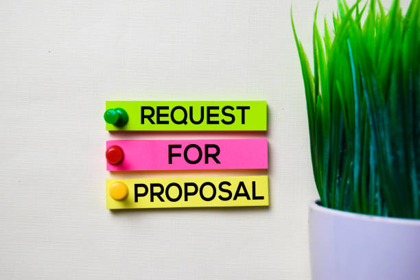 Request For Proposal text on sticky notes isolated on office desk stock photo