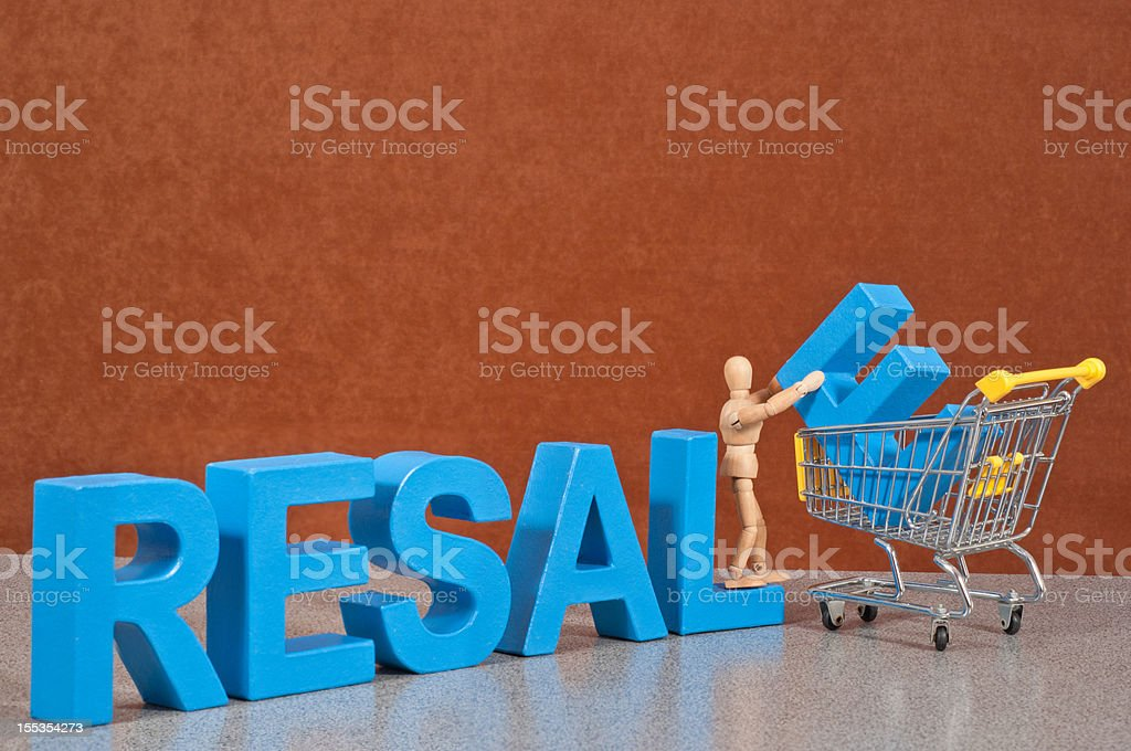 Resale - Wooden Mannequin demonstrating this word stock photo