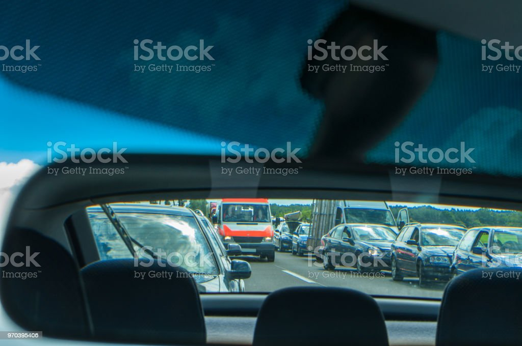 Rescue Alley - Rettungsgasse - ambulance on the german highway in car mirror stock photo