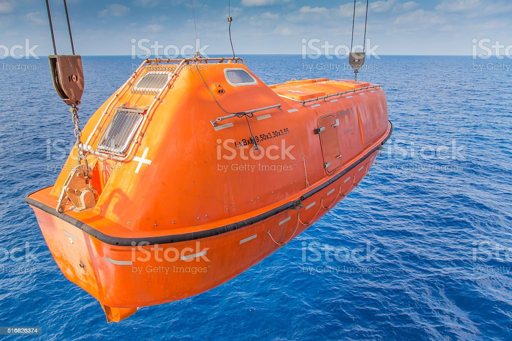 rescue boat or life boat at oil and gas platform stock photo