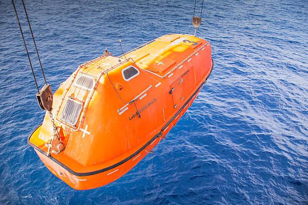 rescue boat or life boat at oil and gas platform - livbåt bildbanksfoton och bilder