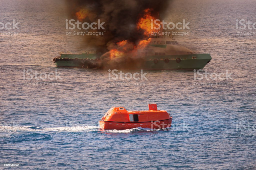 rescue boat performed demobilization passenger from supply boat because fire or worst case, Marine control contacting to rescue team or fire fighter team to help crews boat out of the bad location. stock photo