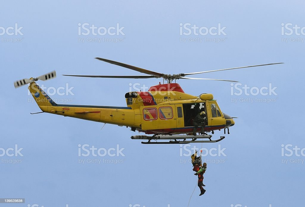 rescue by helicopter stock photo