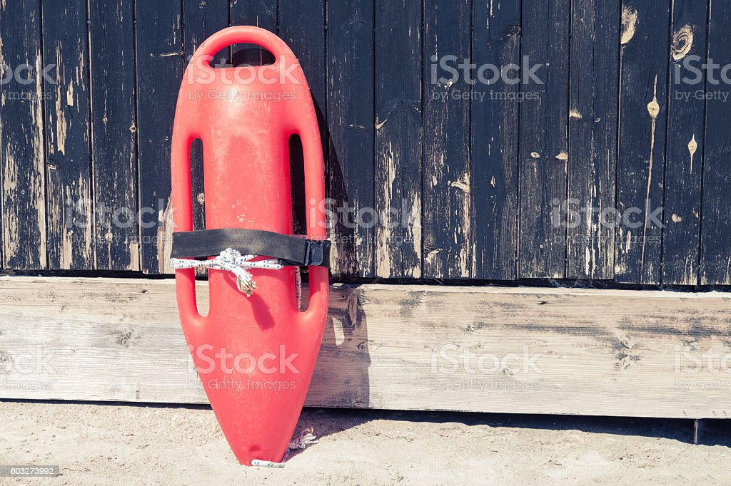 Rescue can on wooden wall at the beach stock photo