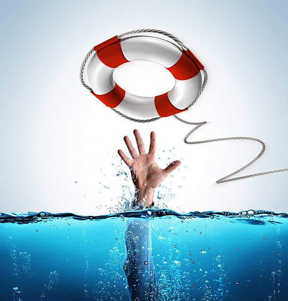 Rescue Concept - Lifesaver As Aid Of Businessman Drowning Preserver in rescue of man in drowning buoy stock pictures, royalty-free photos & images