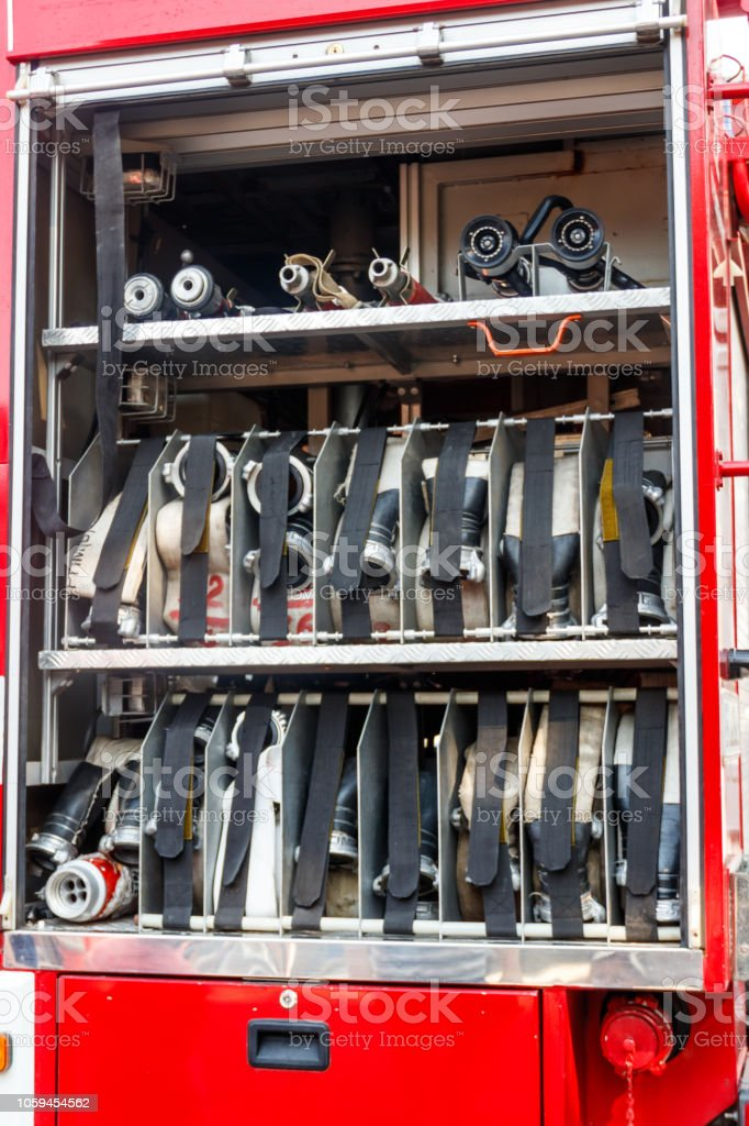 Rescue fire truck equipment. Compartment of the rolled up fire hoses...