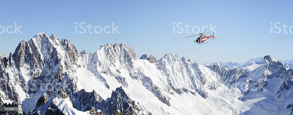 Rescue helicopter in Alps stock photo