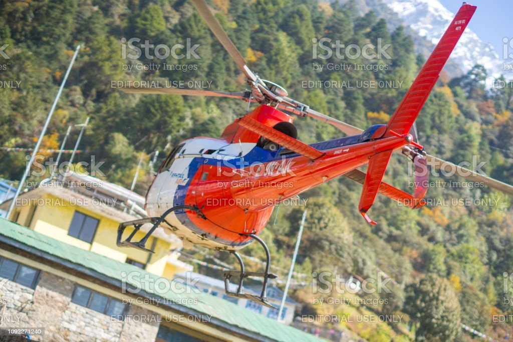 Rescue helicopter in Lukla airport in Himalayas stock photo