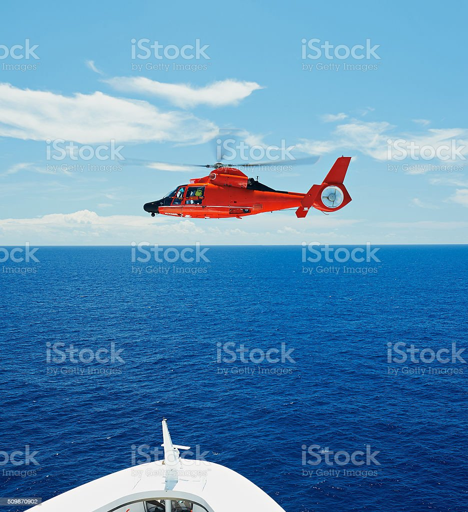 Rescue helicopter in sky stock photo