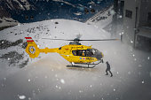 Hintertux, Austria - February 25.02.2020: Just landed rescue helicopter in winter landscape at Hintertux glacier in Zillertal.