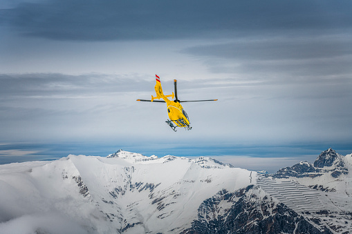rescue helicopter in winter landscape in Austria