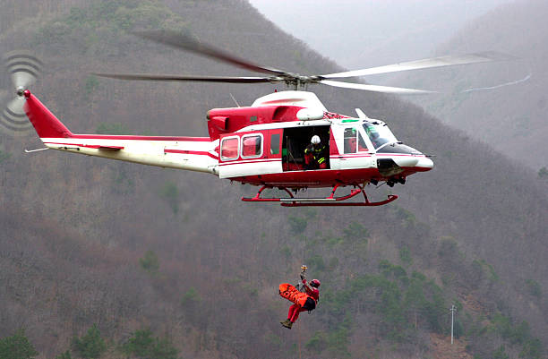 rescue helicopter - cable winch stock photos and pictures