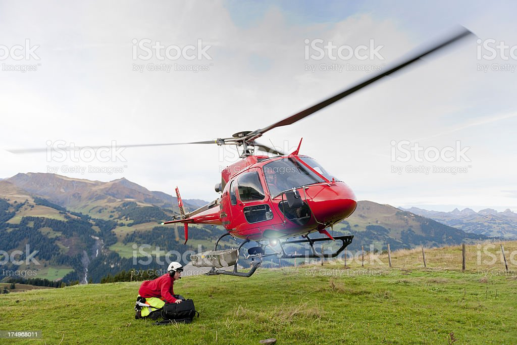 rescue helicopter taking off from mountain stock photo