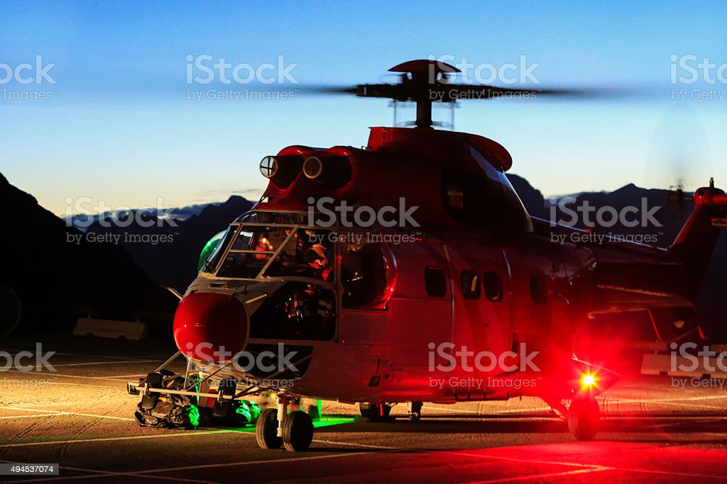 Rescue helicopter to intervene in the Dolomites stock photo