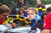 Val Della Torre, Italy - September, 28 2014: Simulation of road accidents, joint intervention between firefighters and rescuers (Red Cross).  Demonstration held in September 2014  in the province of Turin in Piedmont (Italy)