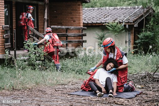 istock Rescue team helping injured female victim 615424918