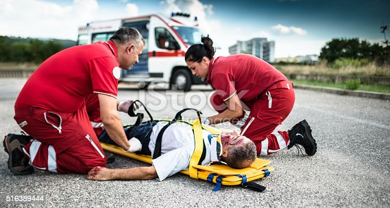istock rescue team helping injured man 516389444