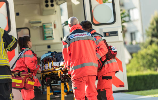 rescue team helping victim of car crash - paramedic stock pictures, royalty-free photos & images