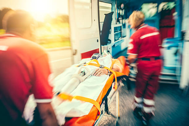 rescue team providing first aid - ambulance stock photos and pictures