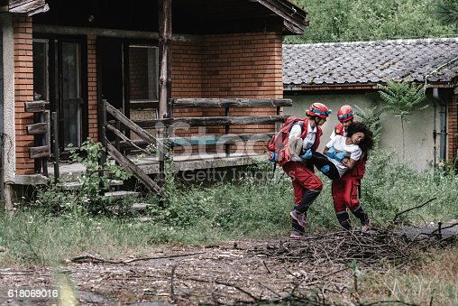 istock Rescue team saving a victim after natural disaster 618069016