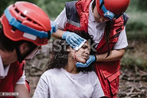 istock Rescue team treating injuries in the field 615424676