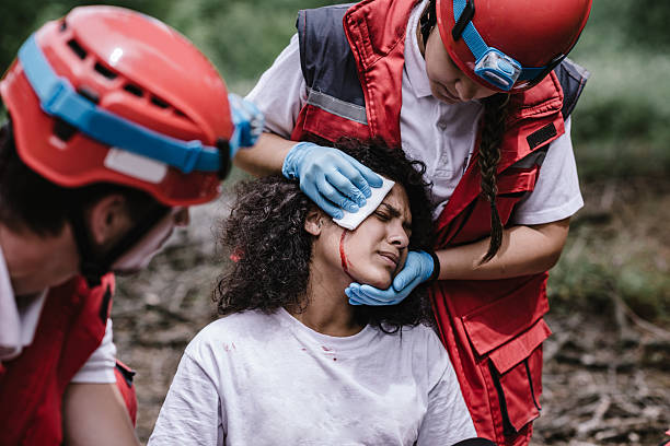 Rescue team treating injuries in the field stock photo