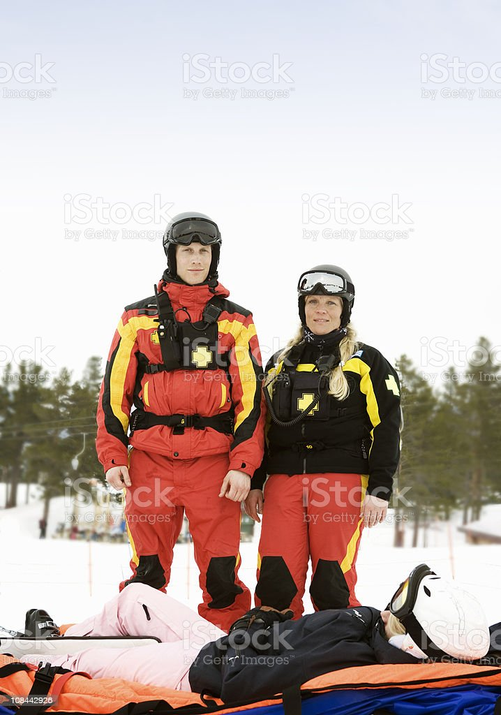 Rescue Team with Skier stock photo