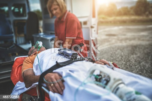 istock rescue team with the ambulance 483720583