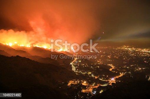 Rescue teams evacuating neighborhood from wildfire