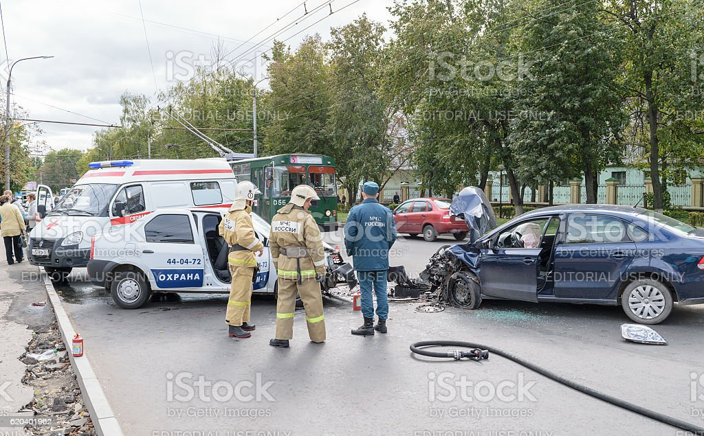 Rescue workers and ambulance car on place of traffic incident, the...