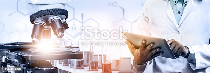 istock Research and development concept. Double exposure image of scientific and medical lab instrument, microscope, test tube and glass flask for microbiology and chemistry in laboratory for medicine study. 1166919895