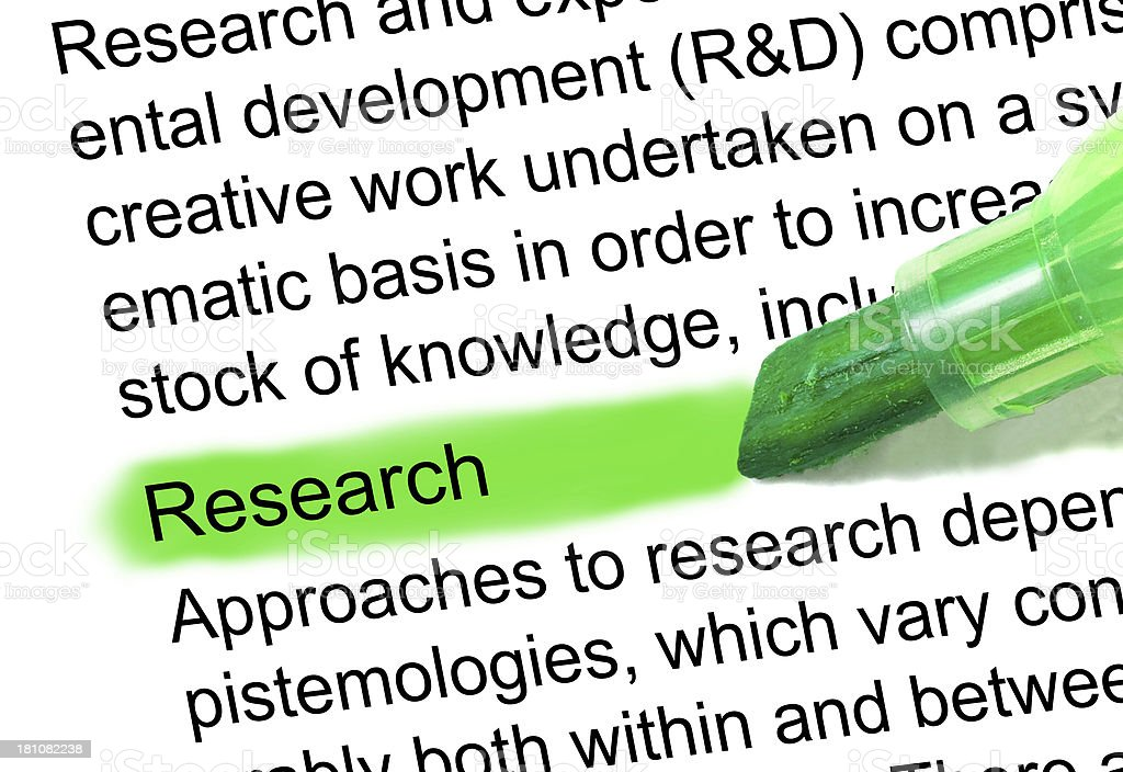 research definition marked in dictionary stock photo