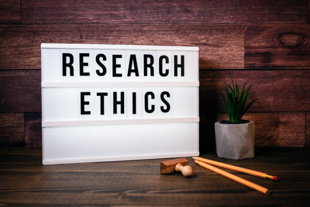 Research Ethics. Text in Lightbox stock photo