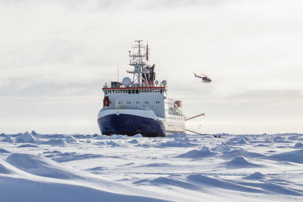 Cтоковое фото Research icebreaker and helicopter