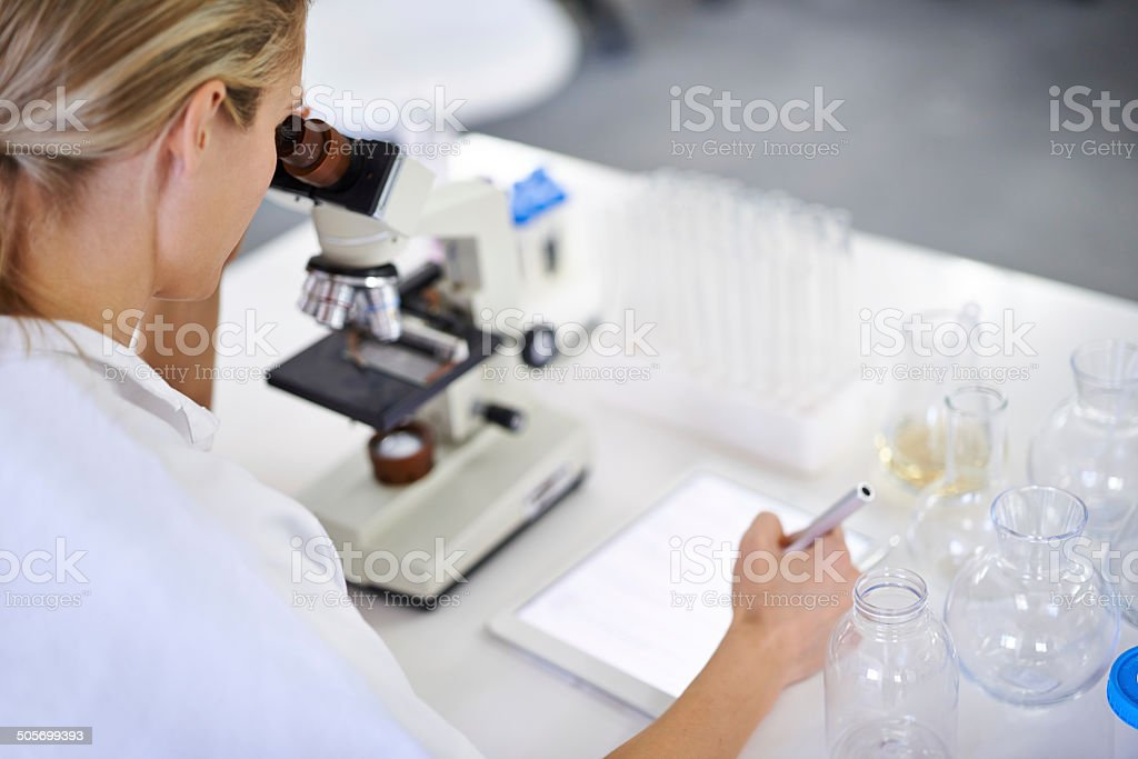 Research is nothing if you don't record your findings stock photo
