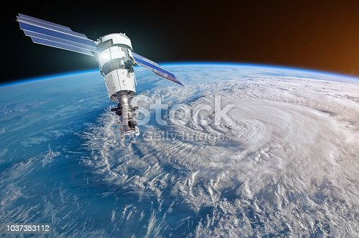 istock Research, probing, monitoring hurricane Florence raging on the coast. Satellite above the Earth makes measurements of the weather parameters. Elements of this image furnished by NASA. 1037353112