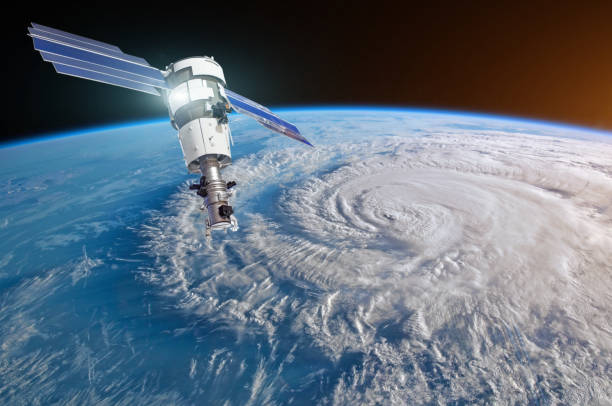 research, probing, monitoring hurricane florence raging on the coast. satellite above the earth makes measurements of the weather parameters. elements of this image furnished by nasa. - satellite foto e immagini stock
