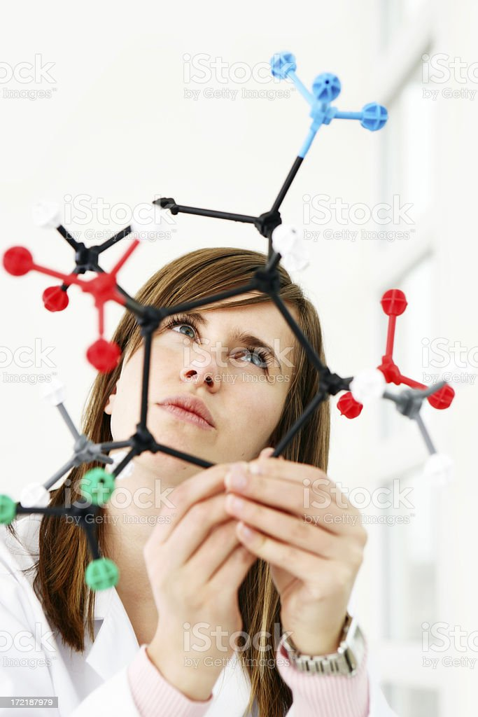 Researcher looking at a molecular structure royalty-free stock photo