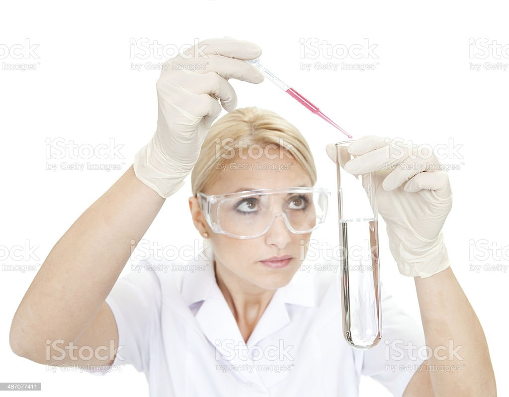 Researcher mixing liquids inside the tube royalty-free stock photo