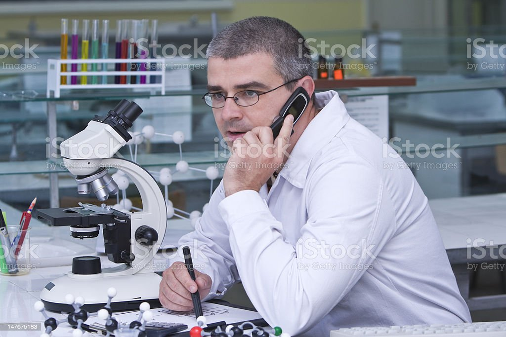 Researcher using a mobile phone royalty-free stock photo