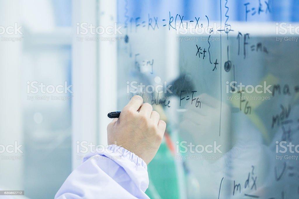 researcher write on widow formula stock photo