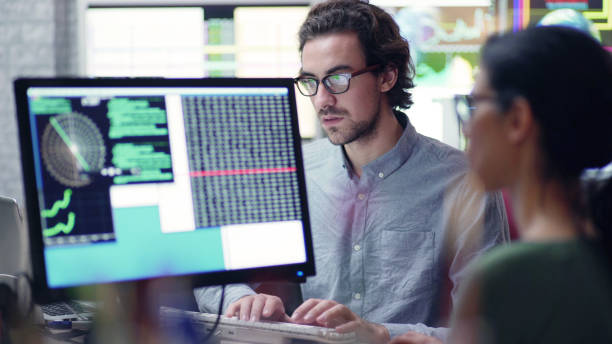 Researchers with multiple monitors stock photo