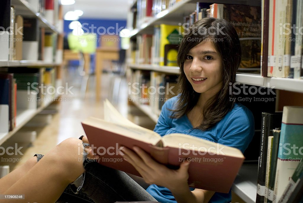 Researching at the library royalty-free stock photo