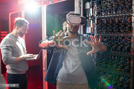 istock Researching database server with augmented reality 1153742611